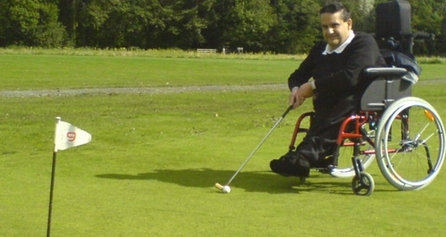 Person in wheelchair playing golf