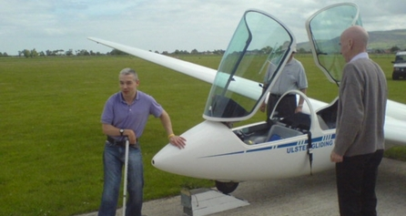 Person with disability beside a glider