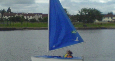 Two people sailing on a small boat